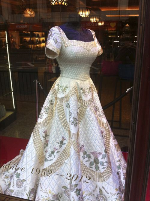 This stunning costume is a reproduction of Queen Elizabeth II's coronation gown, which was designed by Norman Hartnell in 1952/1953