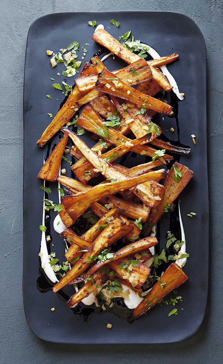 This Middle Eastern inspired recipe for Harissa-roasted parsnips makes a great side for roast lamb. Serve with a cool yogurt dressing and scatter with parsley.