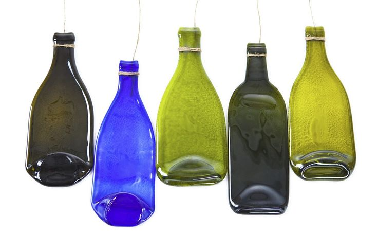 Homemade flattened glass bottles | eHow UK  In your home oven- sounds involved, but would like to try.