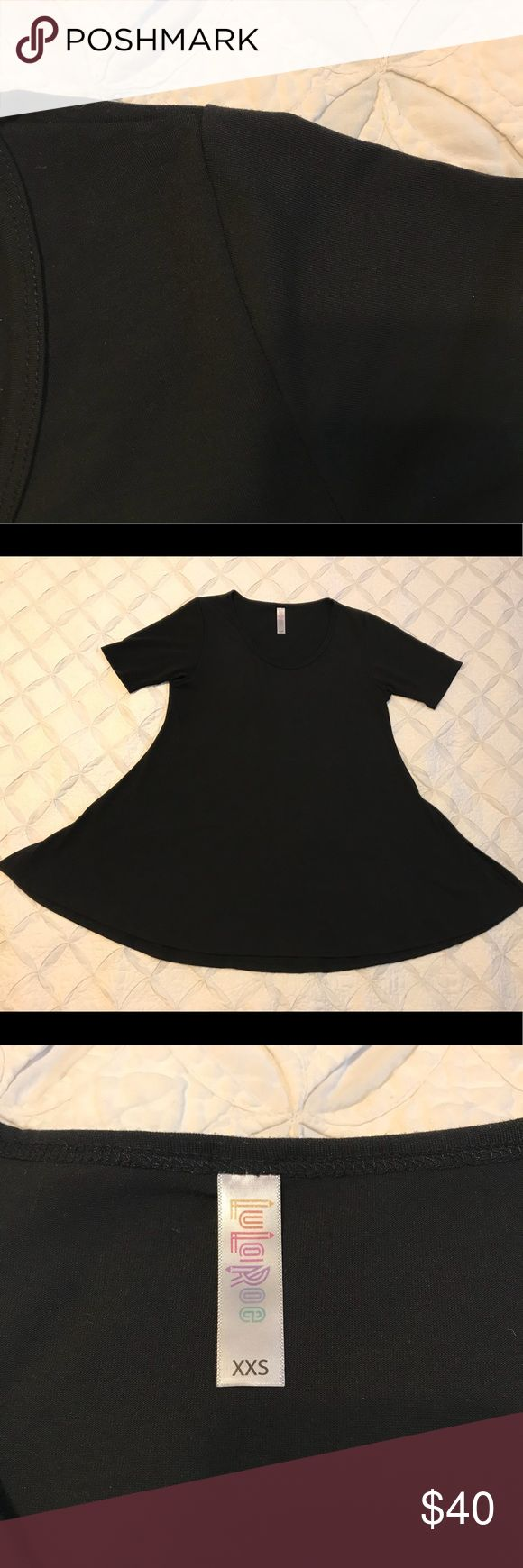 Solid Black LuLaRoe XXS Perfect T Only worn a few times and is in excellent condition. Really nice dressy fabric. Not cottony or faded.  96% Polyester, 4% Spandex The neckline isn't as big as some others I've tried on. LuLaRoe Tops Blouses