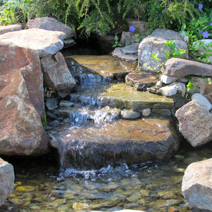 Best 25 rock waterfall ideas on pinterest for Koi pond rocks
