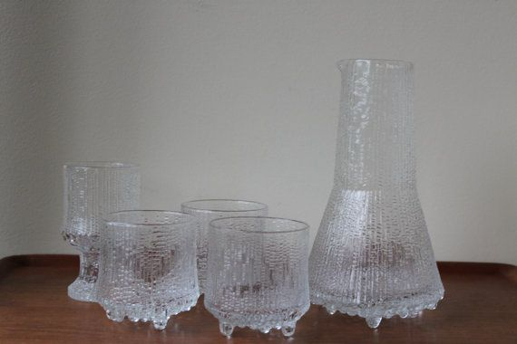 Ultima Thule On The Rock Glasses (3) Carafe has been sold.  Designed by Tapio Wirkkala Since there is no sticker left, it is impossible to tell if it is by Iittala or Nuutajarvi.  Glasses measure: 8cm in top diameter 8.7cm tall.  3 1/8 in top diameter 3 3/8 tall  No chip or crack. Im trying to determine the official title for these glasses based on the measurements. It is confusing since all highballs, on-the-rock, and 7 Oz Flat Tumbler are all described as 3.5 tall according to rep...