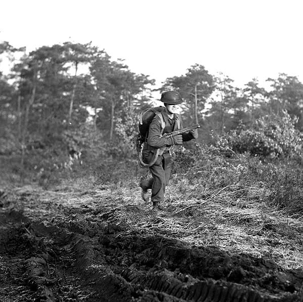 Private W. Smith of The Highland Light Infantry of Canada training to operate a Lifebuoy flamethrower, Nijmegen, Netherlands, 14 December 1944