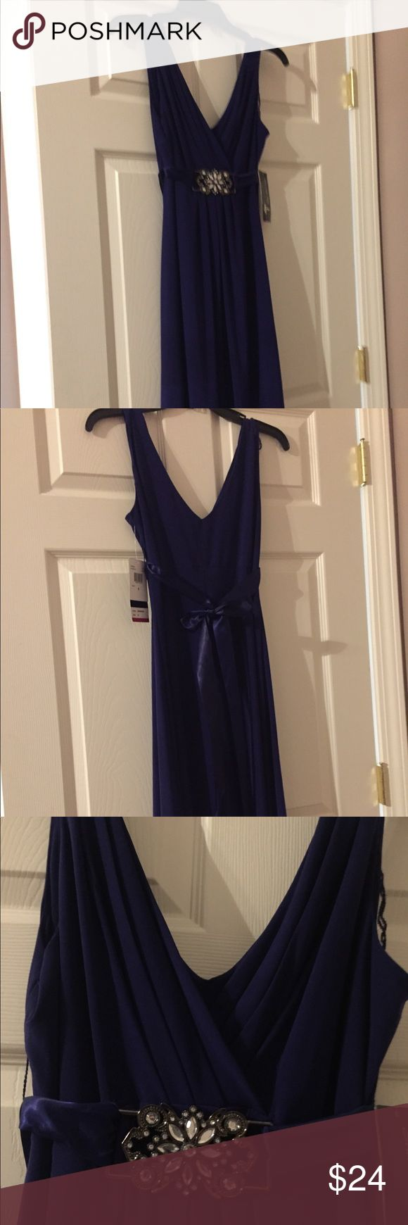 NWT Scarlett Nite Purple Party Dress Size 8 NWT Scarlett Nite  Deep Purple Violet Cocktail/Party/Evening Dress  Size 8 New dress with broach and Ribbon Belt Deep V Neck or plunge top Great to wear to a wedding or an evening out on the town.!  Wear with heels and a velvet choker Scarlett Nite Dresses Wedding