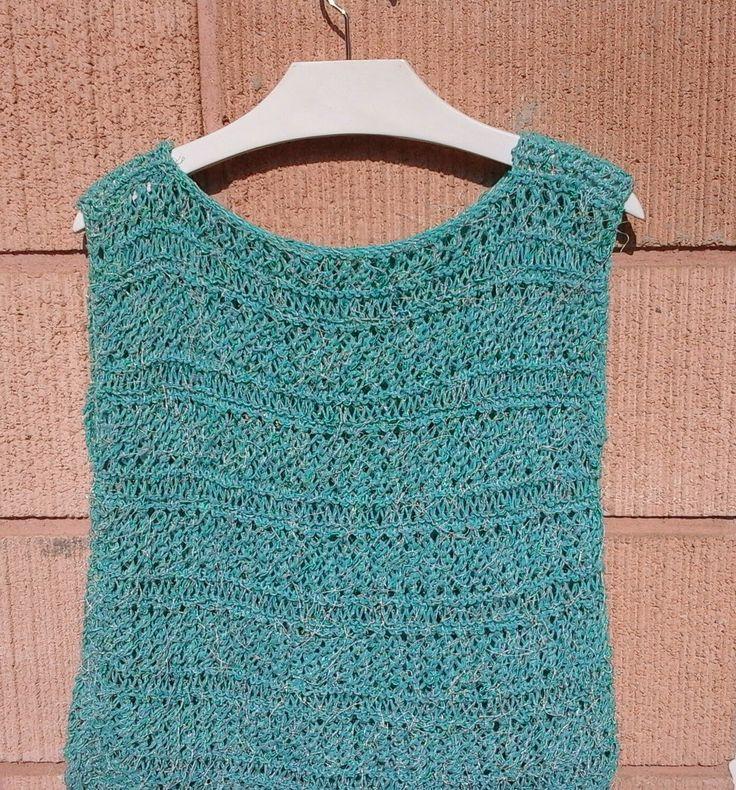 Colocar 67 pontos com um fio fantasia na agulha para tricot nº6 Para começar: tricotar 2 carreiras de ponto tricô, a seguir tri...