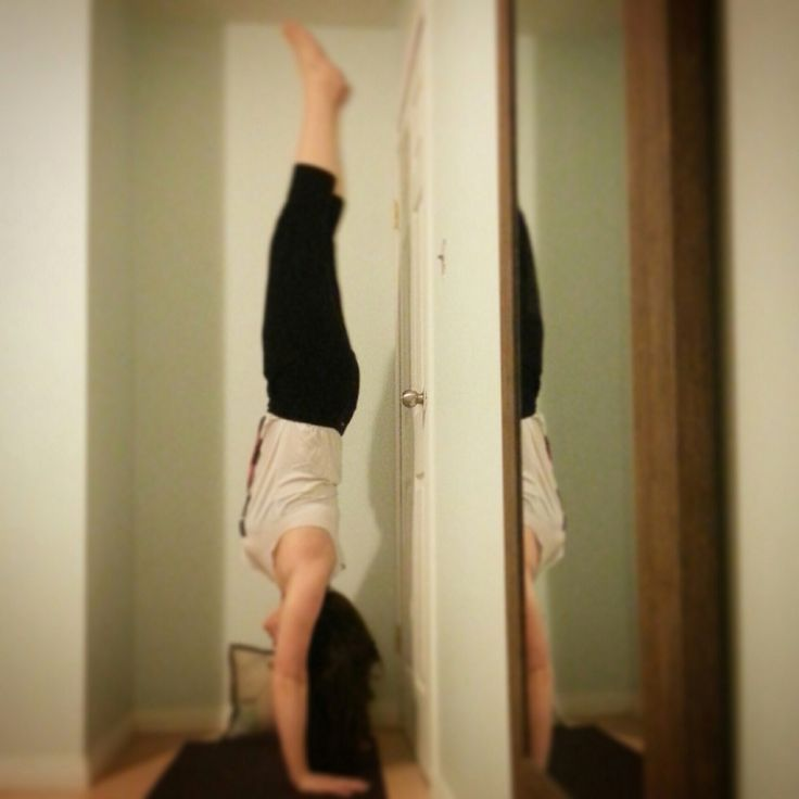 Are you thinking about trying handstand? Find a nice little spot you can walk your feet up the wall so you can start building arm strength and get used to being upside down! - Yoga Teacher Heidi Rae