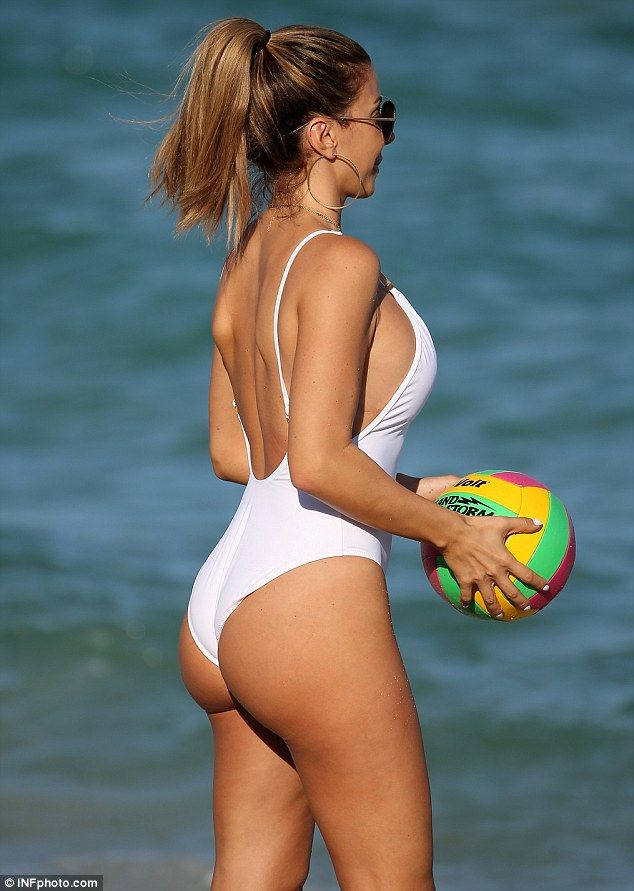 She's booty-ful! The 42-year-old reality star flaunted her phenomenal figure and shapely derriere in a white swimsuit