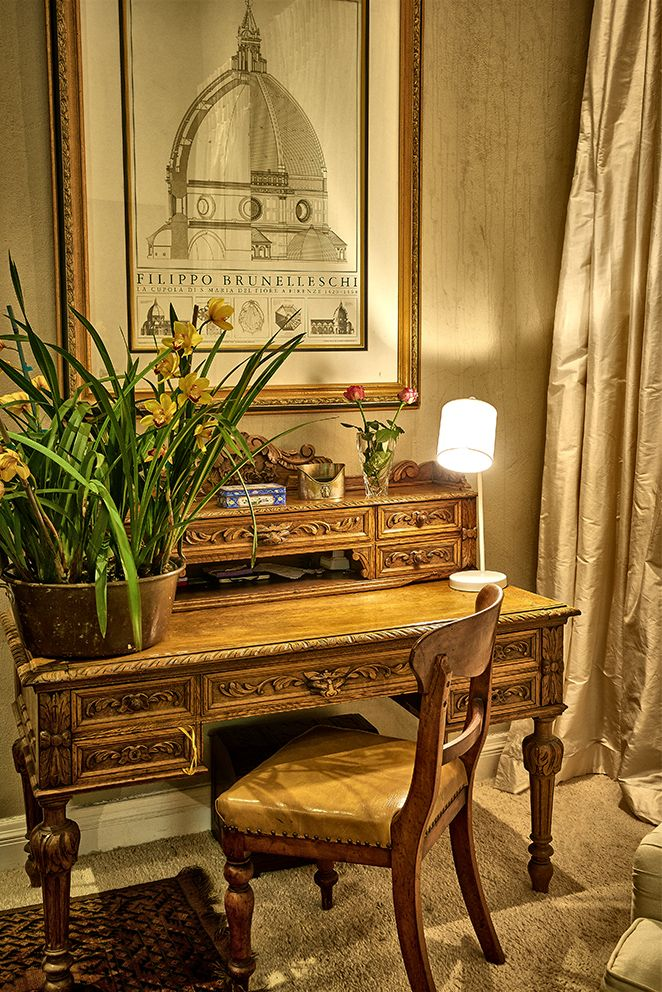 A sophisticated, stylish home in Johannesburg, showcasing a creative mixture of colours, styles and textures. Abundant use of original artworks and strong colour statements. Impressive classical furniture used to create an intimate study nook.