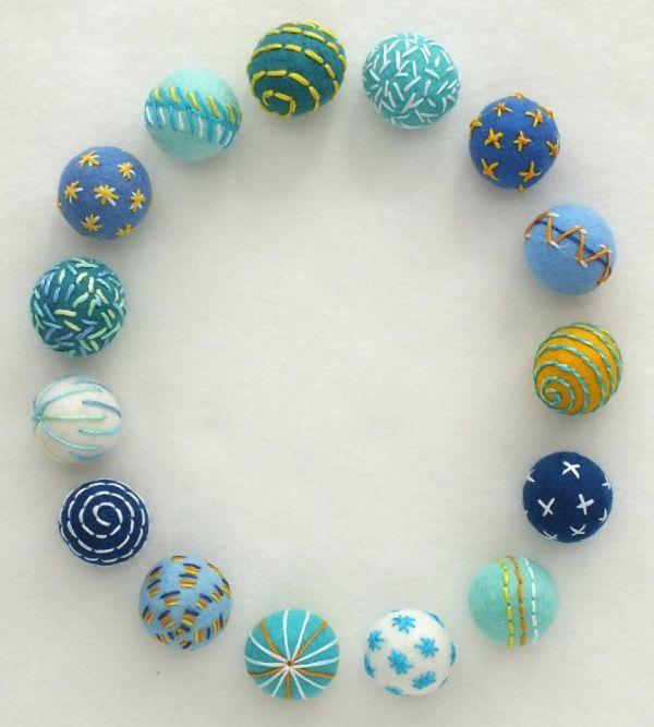 Simple embroidery on felt beads