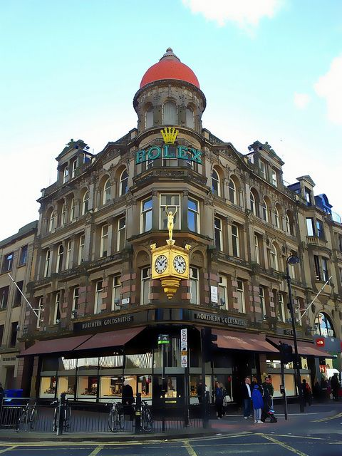 Goldsmiths corner, Blackett St., Newcastle on Tyne, after £1m refurbishment, featuring gold Rolex clock.