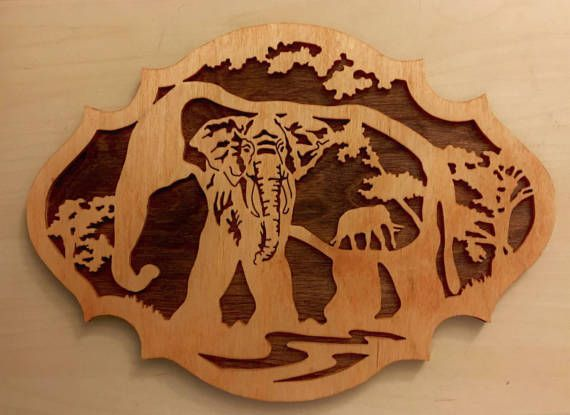 This elephant nature scene is a wooden plaque to hang on your wall.  Get just this one for $40 or get a set of three for $100.