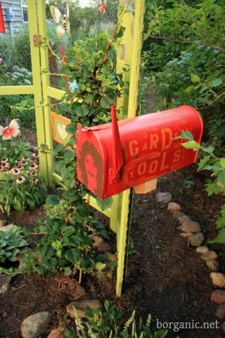 Fun idea for the kids garden tools and I love the old screen door.