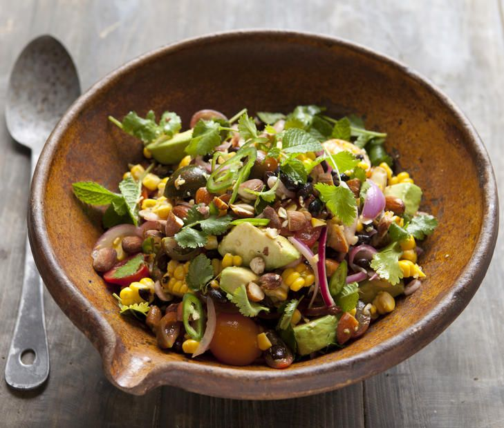 Grilled sweetcorn salad with black beans and pickled onion.