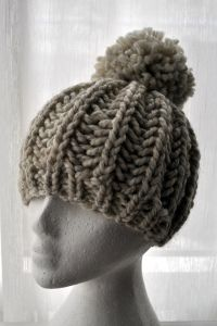I LOVE this hat! Knits up in a couple hours....and I just bought the jumbo pom pom maker for one for myself!