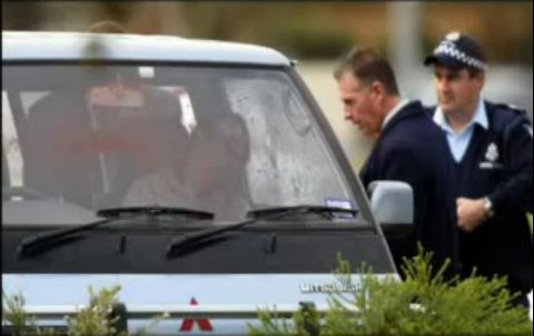 Police attend the scene of Jason Moran and Pasquale Barbaro's murder on 21 June 2003.