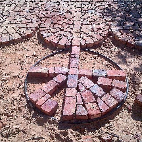 paving with broken and half bricks, concrete masonry, 1 meter irrigation pipe to make circle
