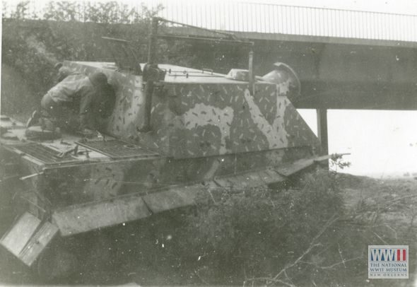 Americans inspect a Sturmtiger painted in Ambush ...