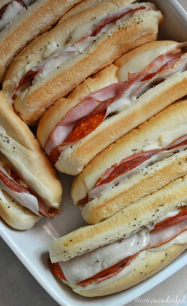 Hot Italian Sandwiches baked in the oven. Meaty Cheesy Sub #Sandwiches, great for feeding a large crowd!