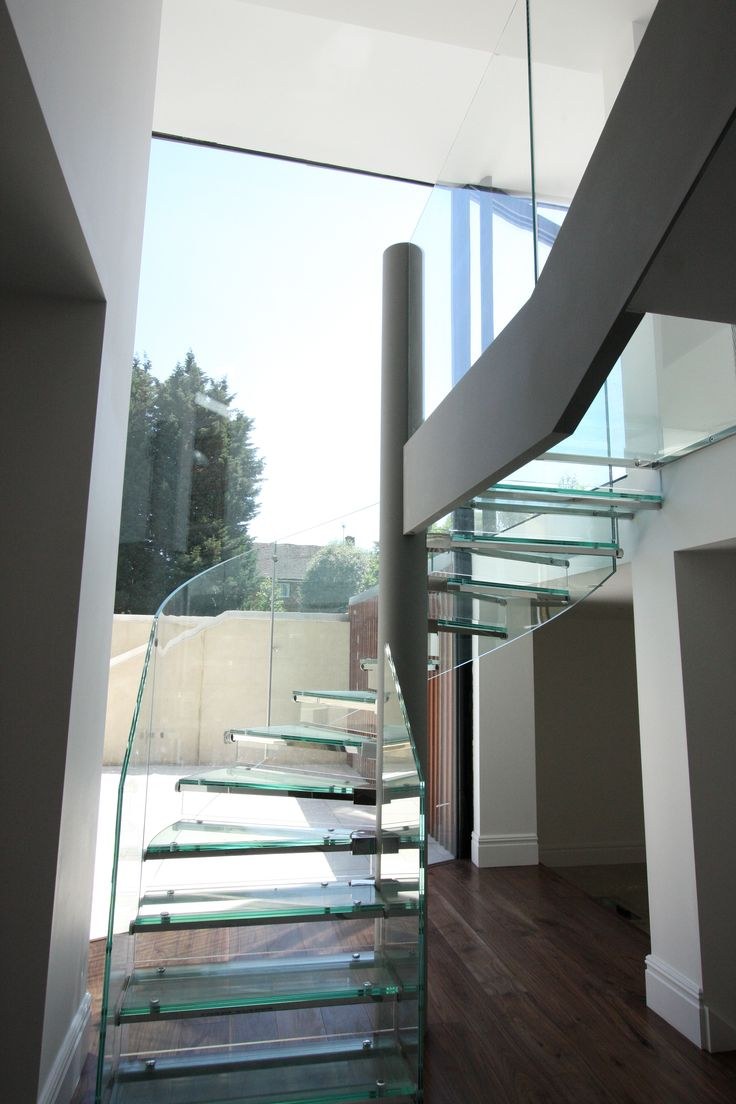 bespoke glass staircase and balustrades featuring double height oversized glazing kew road iq glass bespoke glass staircase