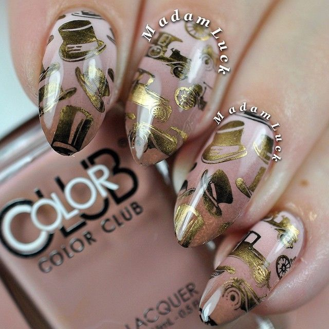 A late night mani . I love how this turned out . I used a new stamping plate by @bundlemonster from their Time Machine Collection- plate BM XL135 which is available on their site - link is in their bio . Polishes used to stamp with are by @mundodeunas ( black and bronze ) . Base colors used in my gradient are by @colorclubnaillacquer most from their shift into Neutral Collection . Top coat using is by @pscosmetics named Artiste!