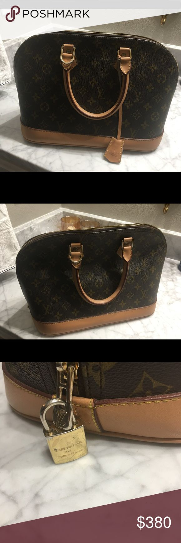 Louis vouitton handbag Louis vouitton handbag with serial number. In good condition. Does have some pen marks on the inside of bag. Louis Vuitton Bags Satchels