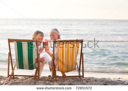 Senior couple drinking a cocktail - stock photo