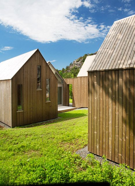Glass-fronted cabins form Norwegian holiday home for three generations of the same family.