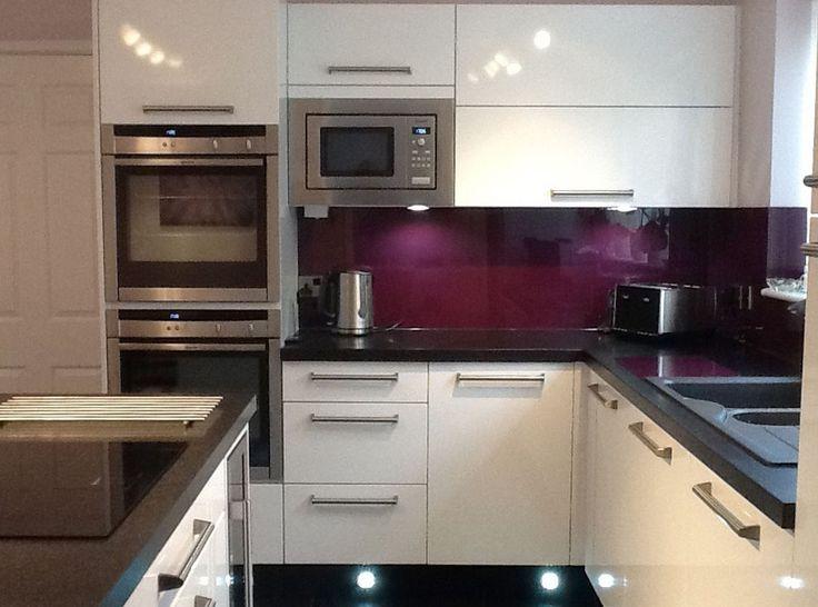 Deep purple (aubergine) acrylic sheet backsplash. Love this color.