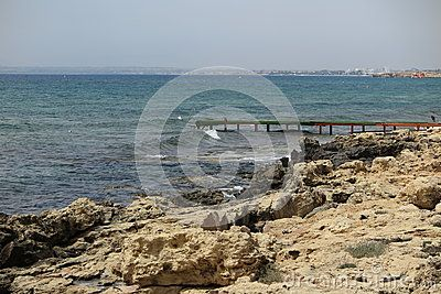 Sea rocks and small pier in Ayia Napa, Cyprus.