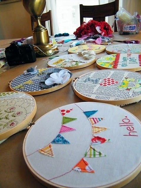 embroidery hoops..maybe just one or two for shelves in baby room, with quilt fabric...love the bunting..but a birdie or inital would be sweet too