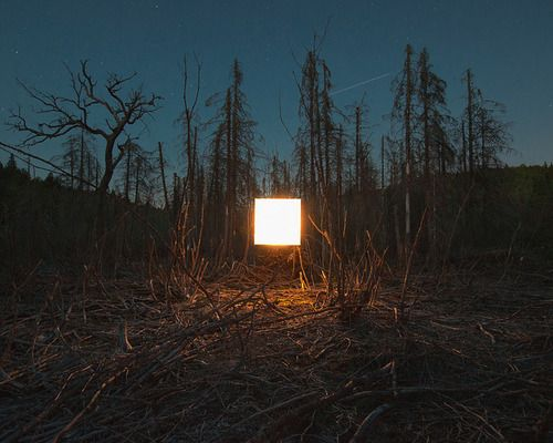 Alternative Landscapes by Benoit Paillé  The 1x1m light is hung from trees using fishing lines, and photographed using exposure times varying from 30 seconds to 4 minutes.