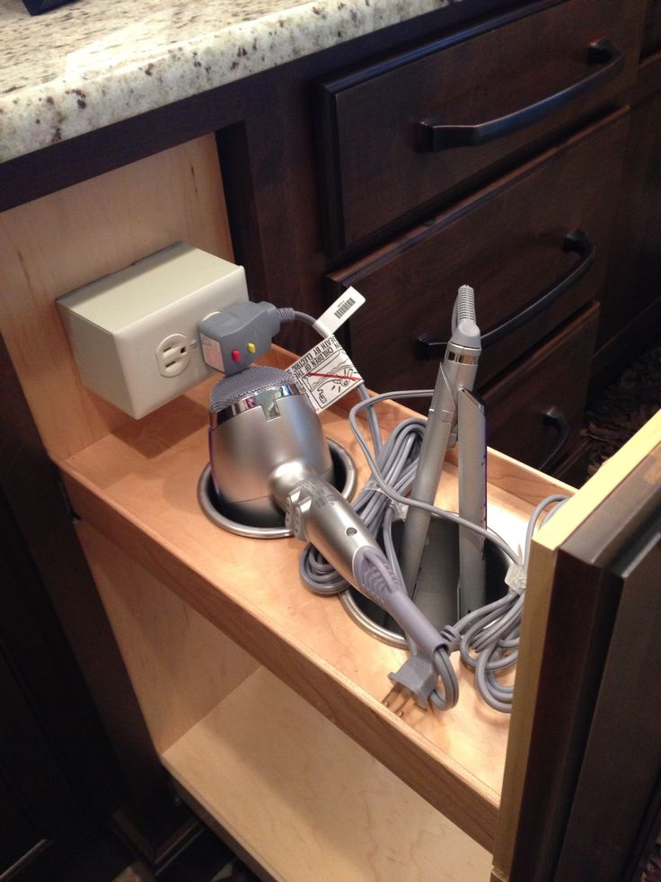 Nifty idea. Cabinet drawer at side of bathroom vanity stores hair dryer and curling iron. Drawer even includes a power outlet. www.garmanbuilders.com