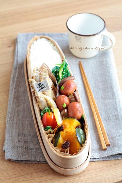 Smelt tempura, white rice, pumpkin and raisin, shitake mushrooms and sausage, spinach nibitashi, cherry tomatoes