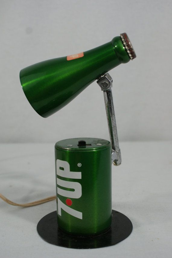 Such a quirky fun lamp!  It even fold s up to look like a a 7UP can, check it out in the pictures. Atomic Style Soda Pop Lamp. Mid Century