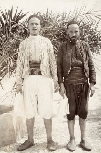 601794. Two men in traditional Moroccan clothing and balgha shoes.