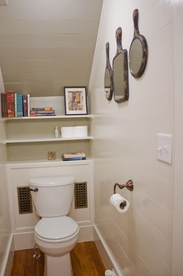 You know you live in an old house that lacks space when a bathroom under the stairs makes you happy