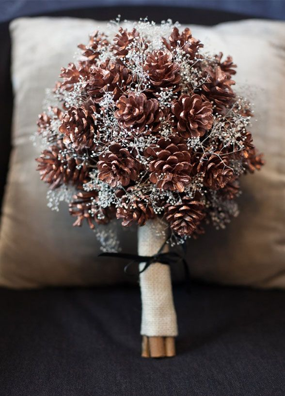 Pinecones add a fun seasonal element to this whimsical bouquet. Check out our 10 absolutely gorgeous winter wedding bouquet ideas.