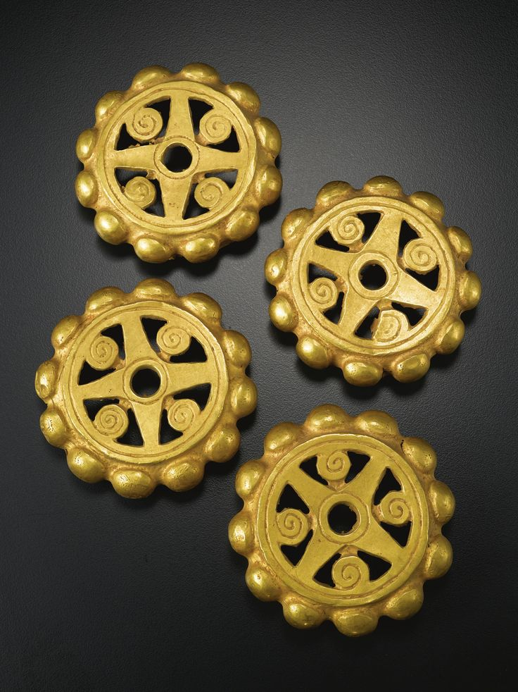 PAIR OF COLOMBIAN GOLD FOIL OPENWORK EAR ORNAMENTS,  CA. A.D. 200-400 the four halves forming a pair of ornaments each of thin gold, with knobbed perimeters and openwork star/scroll central design
