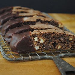Chocolate Biscotti-very good. Try chilling the dough for one hour before shaping. Use cocoa powder to coat hands, not flour!