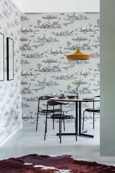Cole & Son Zambezi wallpaper in Neutral features a flotilla of boats, originally sculpted by Sotho artist Benet Zondo, captained by an array of animals all floating gently down the Zambezi river in Zimbabwe. Inspired by Operation Noah, a mission led by people in boats to save drowning animals when the Zambezi flooded in the 1960s, this delightful wallpaper will be loved by children and adults alike. Softly coloured zebras monkeys, elephants and hyenas all feature as do the occasional…