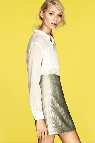 A metallic skirt or short is ESSENTIAL this summer. Pair it with a white shirt to make it daytime appropriate.