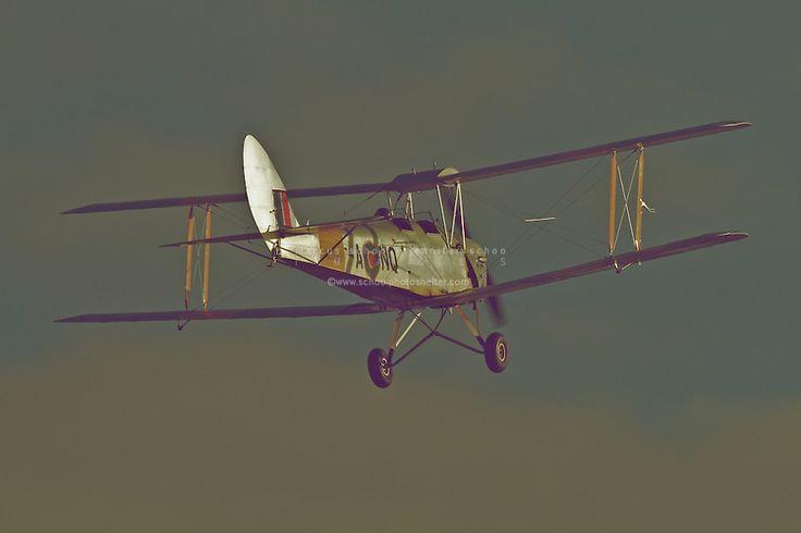 A Tigermoth cruises above Hood Aerodrome, New Zealand. ©2012 Marcus Schoo