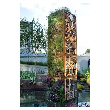 Garden tower edibles and recycled materials for insect for Vertical garden tower