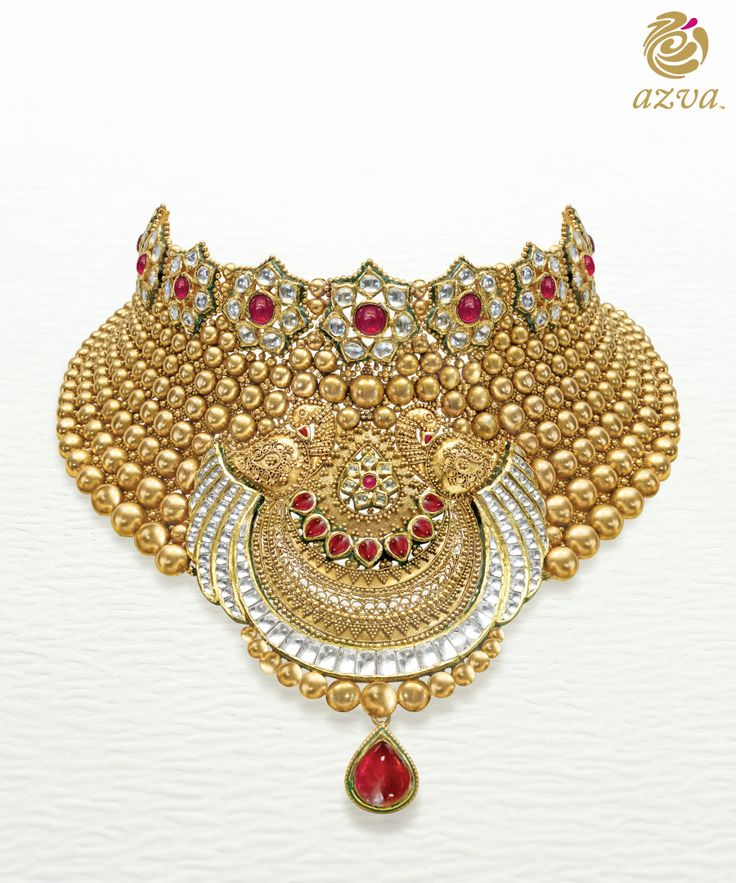 Kundan showstopper with enamel work detail inspired by graceful peacocks. Bridal gold jewellery with style.