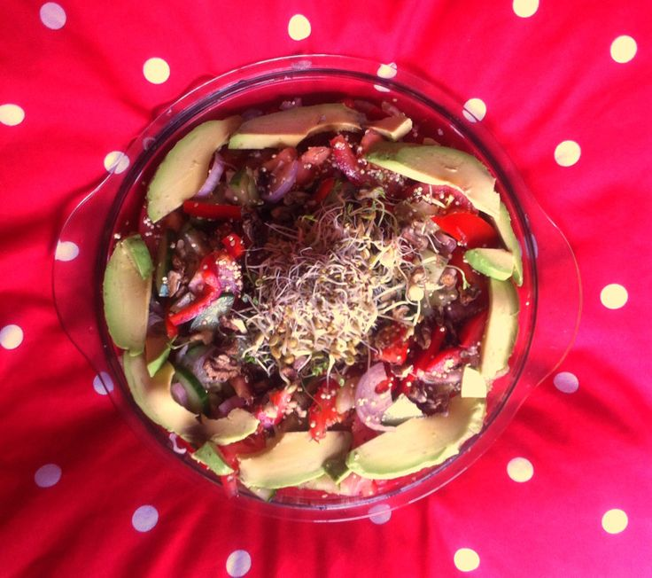 Healthy salad with sprouts and avocado