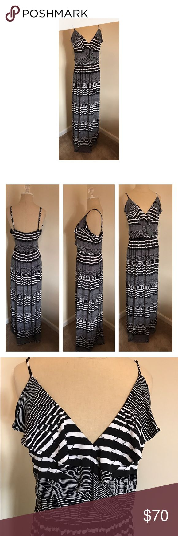 "⭐️Just in⭐️ Betsey Johnson maxi size 14 Sexy Betsey Johnson black and white maxi dress size 14. V-neck at bust with spaghetti straps and flowing ruffle. Elastic at waist and at back. Light jersey fabric. Adjustable straps. Underarm to underarm 20"". Bust, where shoulder strap meets bust, to hem 58"". so this dress is long! Great for someone tall or who loves heels. Like new. Betsey Johnson Dresses Maxi"