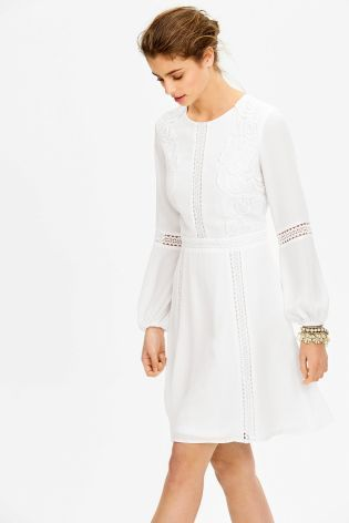 There's nothing more chic than an all white outfit, especially when it's combined with a gorgeous lace detail. Our new lace panel dress is perfect for a summer occasion.