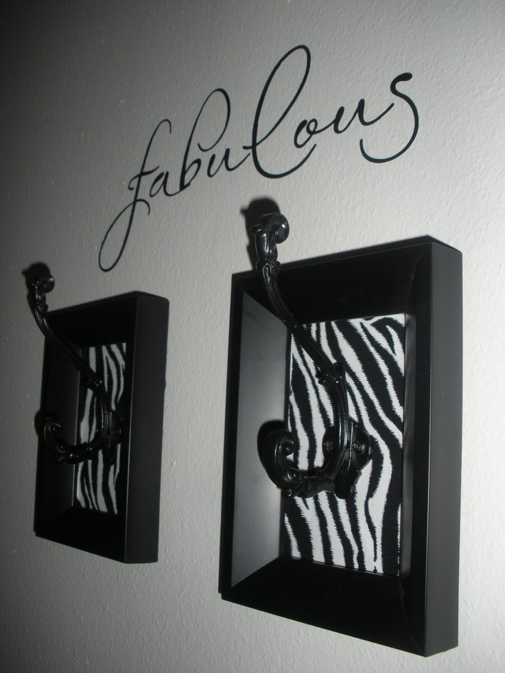 I'm so tickled this came out so well! That's zebra-print fabric in the frames. I highly recommend pre-drilling the holes in the wall to make it easier to hang.