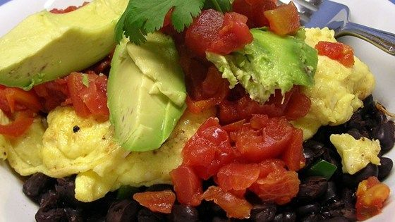 This quick and easy breakfast is loaded with protein and flavor from layers of black beans, scrambled eggs, avocado, and salsa.