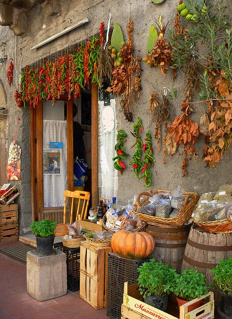 Market in Messina, Sicily...this appealing outdoor display draws you right on into the shop...